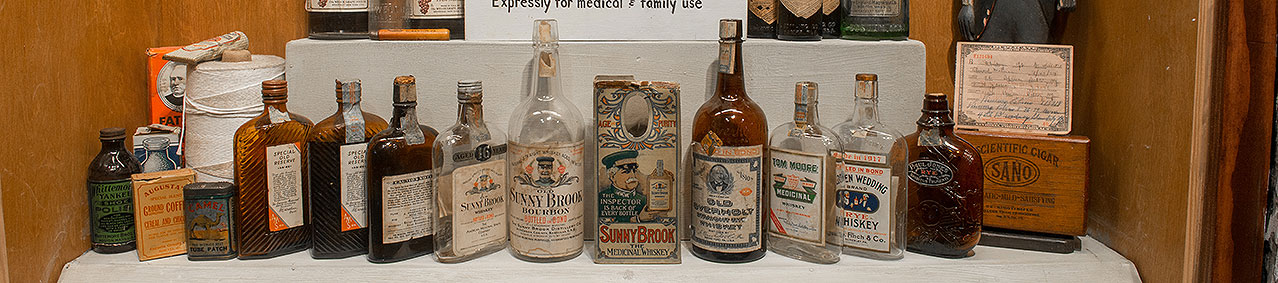 a row of medicinal whiskey bottles on display