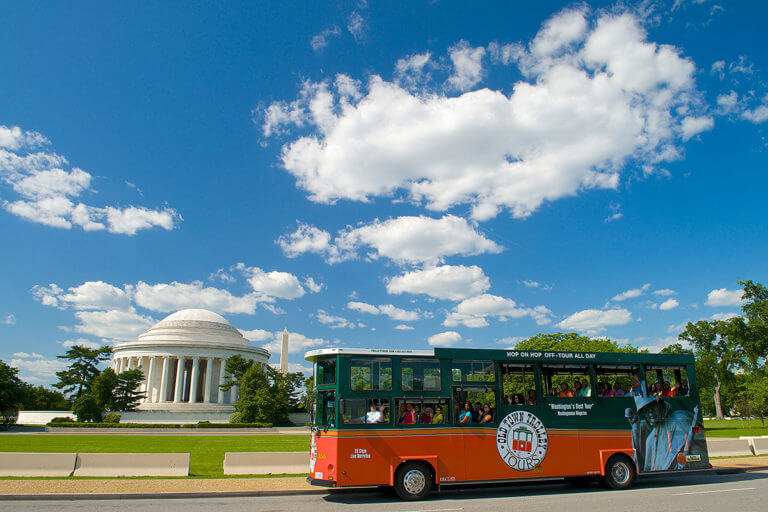 washington dc trolley in front of the jefferson memorial