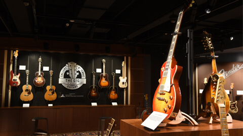 guitars hanging on wall at the gig gallery in nashville