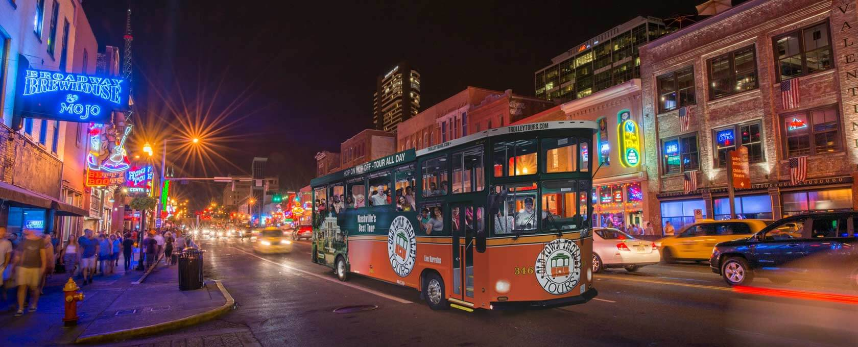 Nashville trolley driving through the city at night