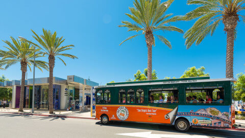 picture of san diego trolley in front of visitor information center