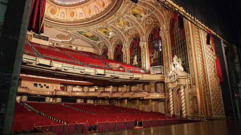 view of boston boch center wang theatre from the stage featuring two levels of seating, a stage and ornate ceiling and walls