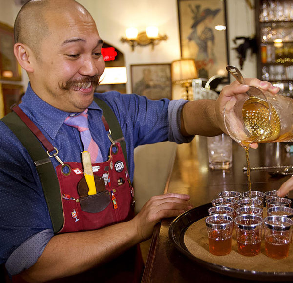 Bartender pouring whiskey at American Prohibition Museum
